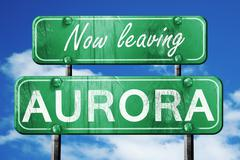 Leaving aurora, green vintage road sign with rough lettering - stock illustration