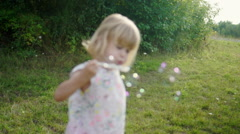 Little Children Playing in Park and Making Bubbles - stock footage