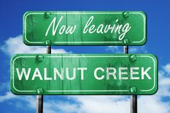 Leaving walnut creek, green vintage road sign with rough letteri - stock illustration