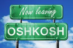 Leaving oshkosh, green vintage road sign with rough lettering - stock illustration