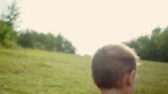 Little Boy Playing in a Park on a Summer Day - stock footage