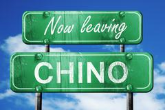 Stock Illustration of Leaving chino, green vintage road sign with rough lettering