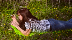 Girl photographs a flower from your phone - stock footage