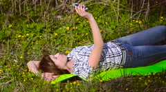 Girl doing selfie with your phone - stock footage