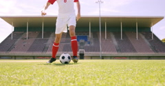 Football player dribbling the ball Stock Footage
