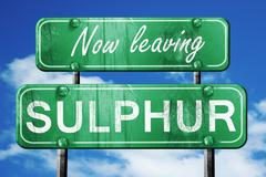 Leaving sulphur, green vintage road sign with rough lettering - stock illustration