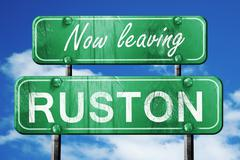 Leaving ruston, green vintage road sign with rough lettering - stock illustration