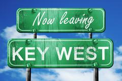 Leaving key west, green vintage road sign with rough lettering - stock illustration