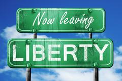 Leaving liberty, green vintage road sign with rough lettering - stock illustration