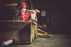 The Man and the Machine. Bulldozer and Excavator Operator Break at Work. Stock Photos