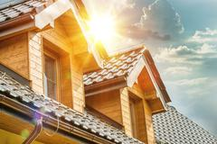 House Roof and Attic Windows Closeup. Sunny Day. Housing and Construction - stock photo
