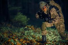 Night Time Special Operation. Running Troop Soldier with Assault Rifle Stock Photos