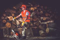 Satisfied Lumber Worker. Timber Industry Concept Photo. Caucasian Lumber Work Stock Photos