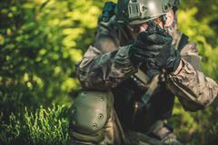 Solider with Handgun. Special Forces Military Mission Concept Photo. Stock Photos