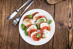 Portion of Mozarella with Tomatoes and Balsamico dressing - stock photo
