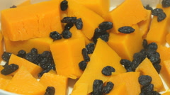 The pieces of pumpkin and raisins in a the steamer Stock Footage