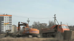 Excavator loads the clay into the dump truck Stock Footage
