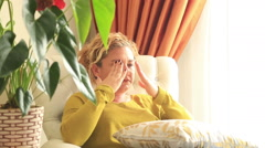 Woman having headache migraine Stock Footage