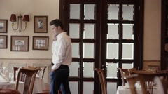 Male white shirt walking and talking on the phone - stock footage