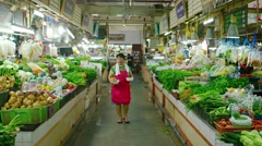 Wide variety of fresh vegetables and produce at indoor public market in Phuke Stock Footage
