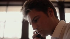 A close-up of the man speaking on the phone Stock Footage