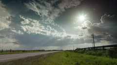 4K - Thunderstorm time-lapse over Florida highway with crepuscular sun rays. Stock Footage