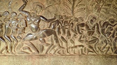 Ancient and intricate relief sculptures on the walls of Angkor Wat Stock Footage