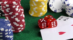 Gambling Red Dice Poker Cards and Money Chips Stock Footage