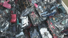 Colorful car wrecks at scrapyard shot by drone Stock Footage