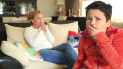 Mother smoking near her coughing child - stock footage
