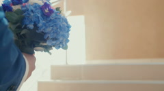 Stylish elegant bride holds a lush bouquet of flowers Stock Footage