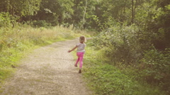 Little Girl Take a Walk Through a Park Stock Footage