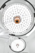 Two surgical lamps in operation room - stock photo