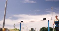 Sportswoman doing hurdle race Stock Footage
