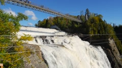 Wide view tilting down the Montmorency Fall In Quebec to reveal the base Stock Footage