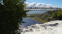 Wide view showing bridge above the Montmorency waterfalls In Quebec City Stock Footage