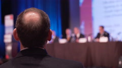 Man listens to panel at a conference - stock footage