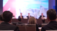 Men learn from a panel at a conference - stock footage