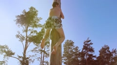A man climbs a pole on holiday carnival Stock Footage