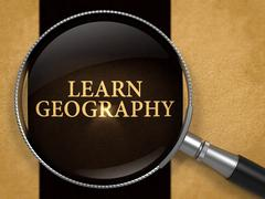 Learn Geography through Lens on Old Paper - stock illustration