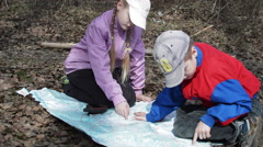 Children Look at the Map of the Campaign. Near Navigator Stock Footage