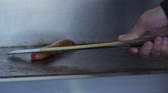 Vendor cooks hotdog in New York City - stock footage