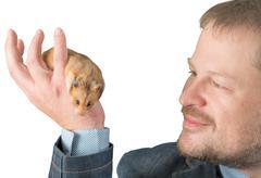Man holding hamster on arm - stock photo