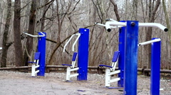 Nature, a lonely fitness gym equipment in the forest, dolly shoot. Stock Footage
