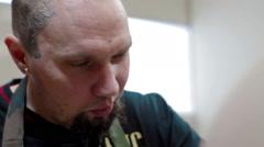 Portrait Tattoo artist make tattoo at studio Stock Footage
