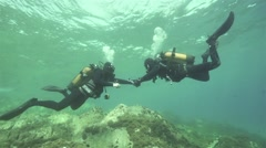 underwater instructor checked by a diver underwater equipment.mp4 - stock footage