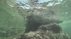 diver jumps into the water to form bubbles of underwater  in slow motion - stock footage