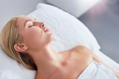Beautiful young blonde relaxing at spa - stock photo