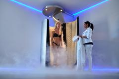 Woman standing in a cryosauna Stock Photos