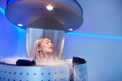 Young woman in a whole body cryo sauna Stock Photos